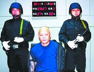 刘连卫在武汉受审。资料图片